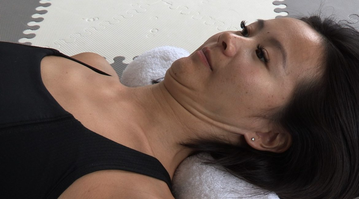 Chin Tuck with Rolled Towel